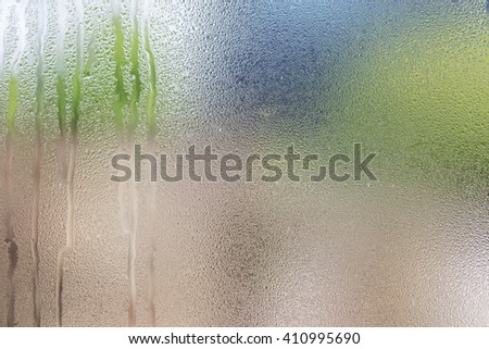Drops of water on glass with green background - stock photo