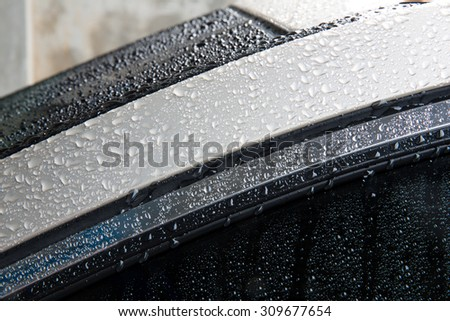 Drops of water on luxury car - stock photo