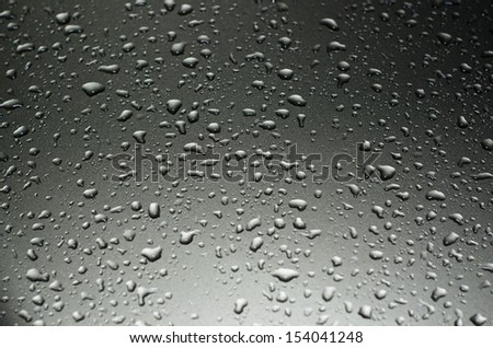 drops of water on metallic surface - stock photo