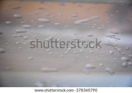 drops of water on the car - stock photo
