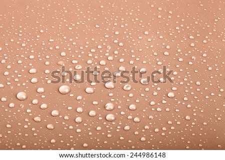 Drops of water on the colored background. - stock photo