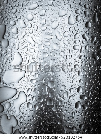 Drops of water on the metal background