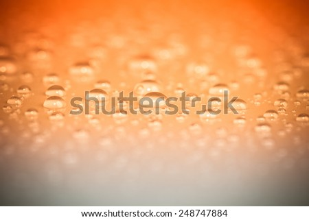 Drops of water on the surface. Shallow depth of field - stock photo