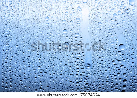Drops on a glass surface with a blue color gradient