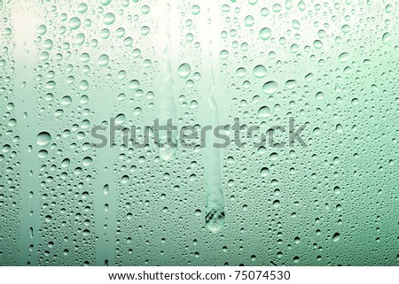 Drops on a glass surface with a green color gradient