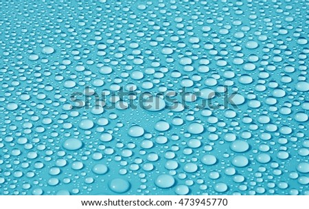 drops water on blue background