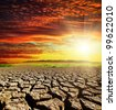drought earth with red clouds and sunset - stock photo