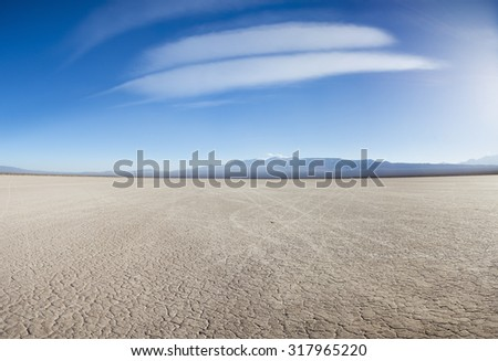Drought land on the Pampa of El Leoncito with the Andean mountains against a clear blue sky. San Juan Province, Argentina - stock photo