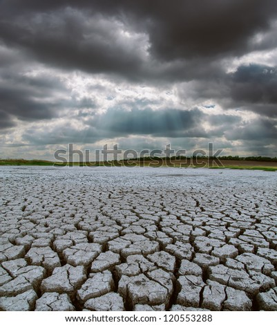 drought land under dramatic sky - stock photo