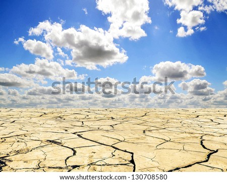 Drought landscape against bright blue sky with clouds - stock photo