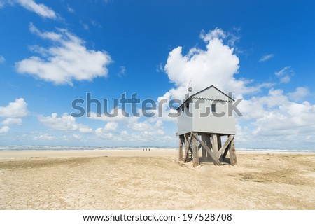 Drowning house at the beach from Dutch wadden island Terschelling - stock photo