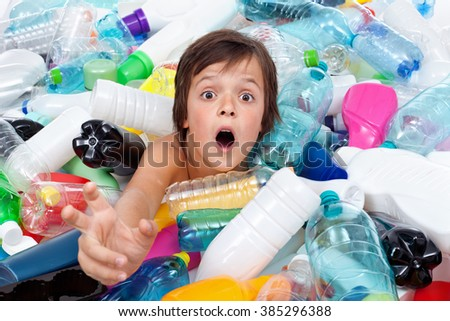 Drowning in the plastic flood - boy reaching out for help from the overflowing garbage