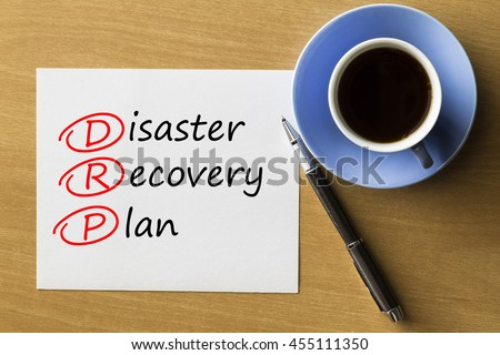 DRP Disaster Recovery Plan - handwriting on paper with cup of coffee and pen, acronym business concept