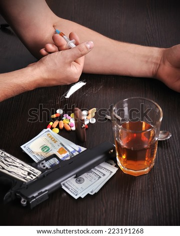 Drug addict man with syringe in action - stock photo