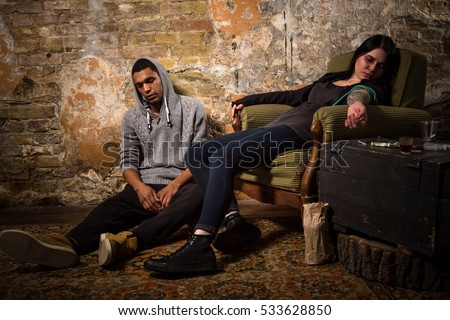 Drug addict sleeping after taking drugs. Man and woman with AIDS resting and relaxing. Disease concept. No to drugs concept.