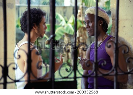 Drug addicted man buying heroine dose from african american pusher - stock photo