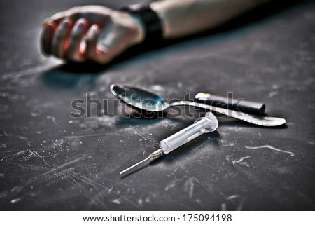 Drug addiction / studio photography of human hand, syringe, spoon and lighter on black background  - stock photo