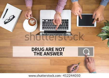 DRUG ARE NOT THE ANSWER man touch bar search and Two Businessman working at office desk and using a digital touch screen tablet and use computer, top view - stock photo