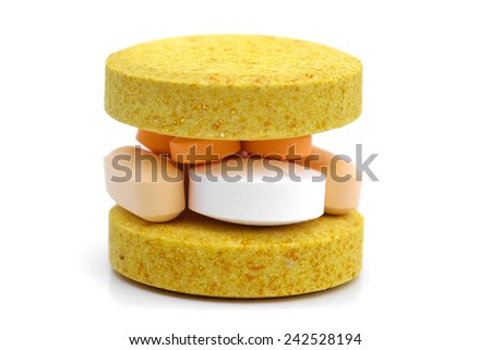 Drug burger. -  Capsules and pills set in a way that look like a burger. - stock photo