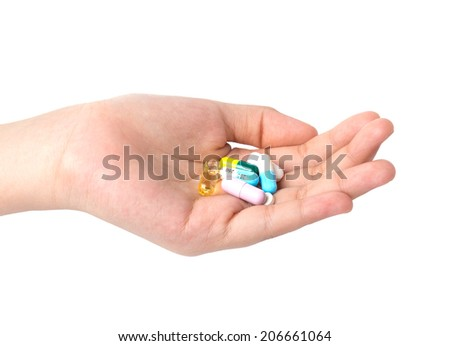 Drug capsules and pills in hand pills in hand  - stock photo