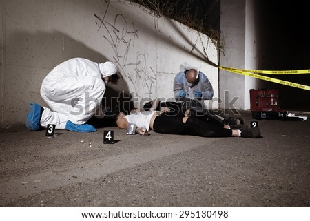 Drug consumers found on city sidewalk  - stock photo