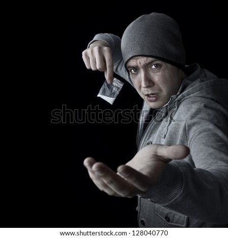 drug dealer selling heroin or cocaine and asking for money with copy space - stock photo