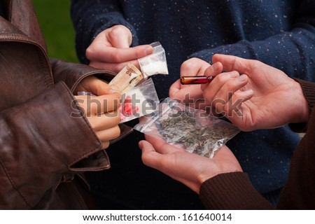 Drug dealer selling pills,marijuana and cocaine - stock photo