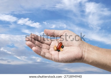 Drug in hand with sky background, Freedom to use drug concept - stock photo