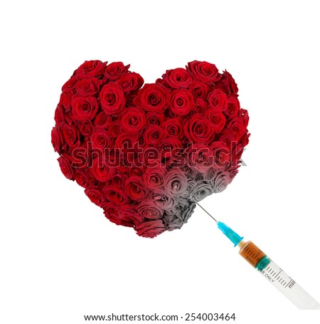 Drug injection into heart shaped bunch of roses. Conceptual photo depicting idea that drugs kill. - stock photo