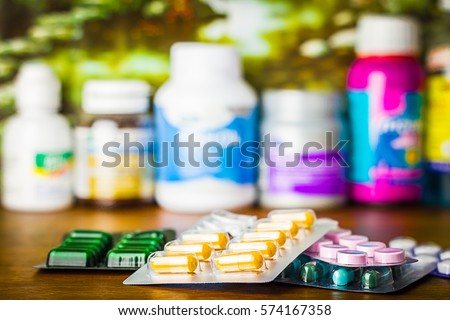 Drug prescription for treatment medication. Pharmaceutical medicament, cure in container for health. Pharmacy theme, capsule pills with medicine antibiotic in packages.