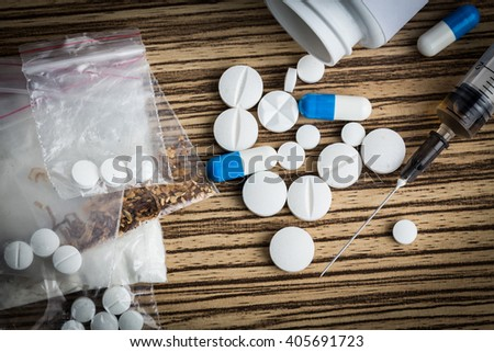 Drug syringe and cooked heroin