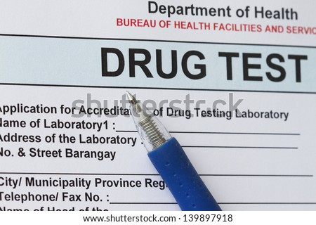 Drug test blank form with blue pen.