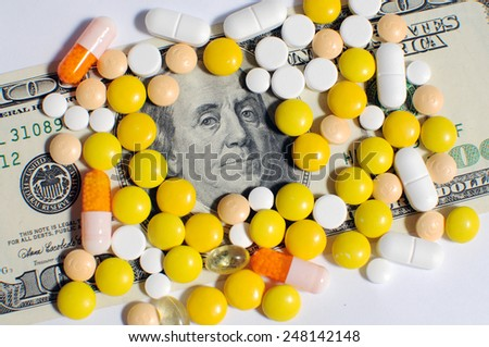 Drugs and dollars - stock photo