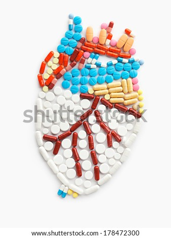 Drugs and pills in the shape of a human heart. - stock photo