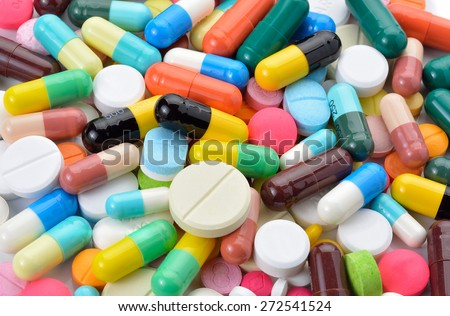 drugs capsules and pills on white background - stock photo