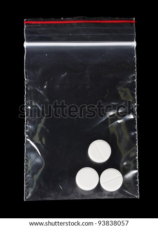 drugs in package on black background