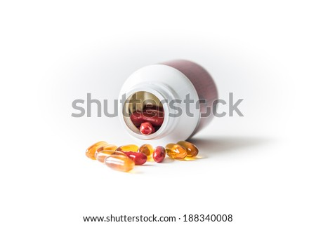Drugs pills and dietary supplement capsules and containers - stock photo