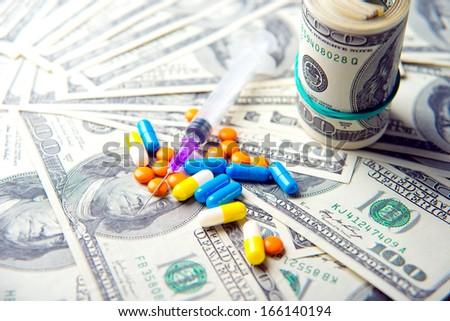 drugs, pills, money, dollars - stock photo