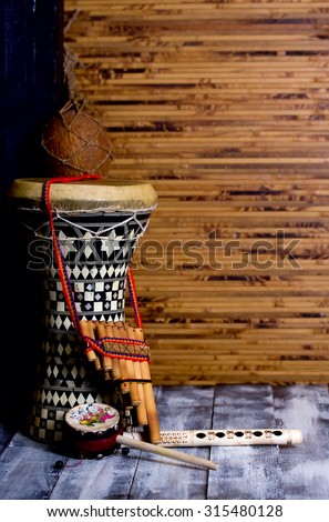 drum and two flutes in the background bamboo mat - stock photo