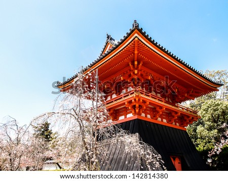 drum house with sakura blossom at Ninna-ji temple, Kyoto, Japan - stock photo