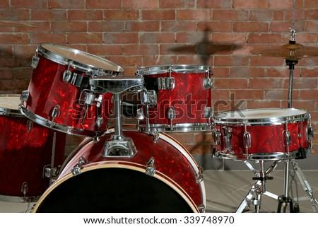 Drum set on brick wall background - stock photo