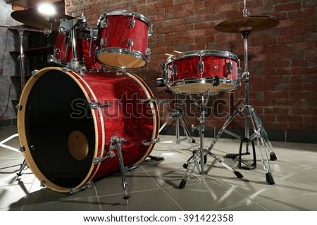 Drum set on brick wall background - stock photo