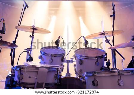 drum set on stage,stage lighting - stock photo