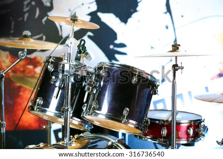 Drum set with focus on hi-hat cymbal - stock photo