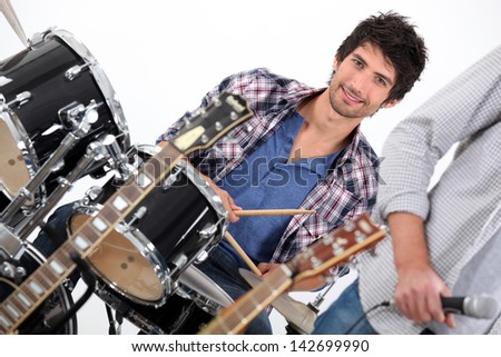 Drummer in a band - stock photo