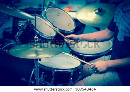 Drummer in the studio, music concept - stock photo