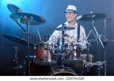 Drummer man to play the drums. smoke background - stock photo