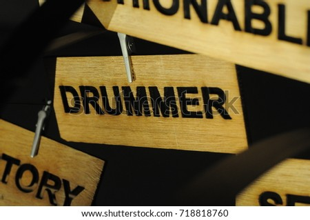 DRUMMER on a wooden sign, photograph Aspirations word