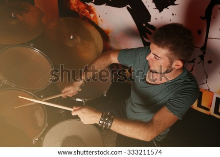 Drummer on dark background - stock photo