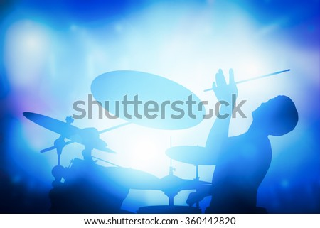 Drummer playing on drums on music concert. Club lights, artist show. - stock photo